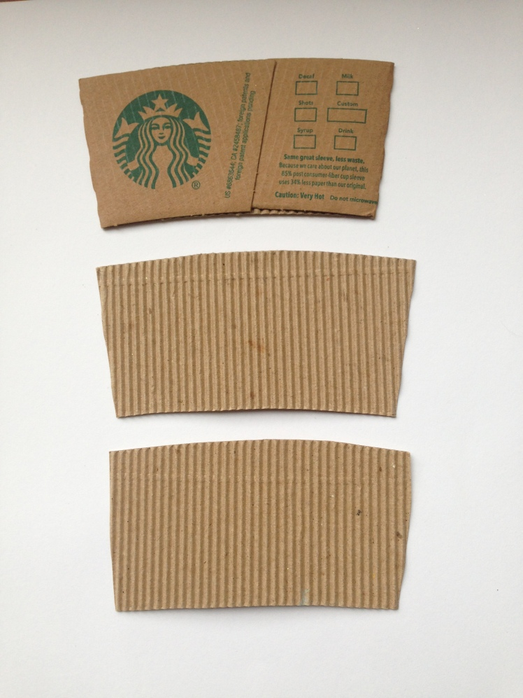 Cut the paper to look like a coffee sleeve